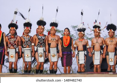 KOHIMA, NAGALAND, INDIA - January 16, 2004 : Ritual dance of Konyak Naga tribes men and women in traditional outfit and headgear.