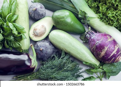kohlrabi, figs and other green vegetables as a background