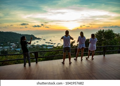 KOHTAO THAILAND - MARCH 3,2018 : unidentified tourist taking a photogrpah at sunset viewpoint on high mountain of kohtao most popular traveling destination in suratthani southern of thailand
