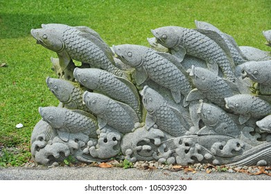 Koi Stone Carving Installation In A Park