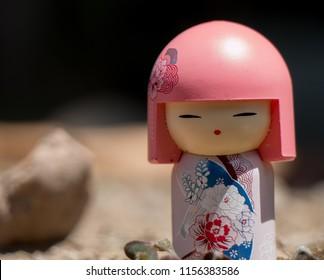 Kokeshi dolls (Japanese doll) on nature background