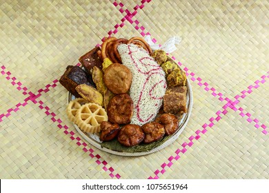 Kokis, Kewum, Aluwa and Aasmi. Sri Lankan Traditional Sweet Foods on Mat