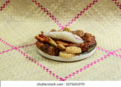 Kokis, Kewum, Aluwa and Aasmi. Sri Lankan Traditional Sweet Foods on Mat