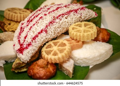 Kokis, Kewum, Aluwa and Aasmi. Sri Lankan Traditional Sweet Food Table