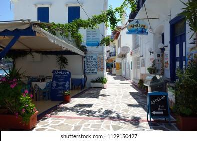 Kokkari, Samos island, Greece - 15 May, 2018: Сolorful street with outdoor restaurants in Kokkari fishing village, Samos Island is popular tourist destination in Aegean Sea