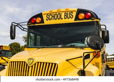 Kokomo - Circa October 2016: Yellow School Buses in a District Lot Waiting to Depart for Students IV