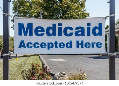 Kokomo - Circa September 2019: Medicaid Accepted Here sign. Medicaid is a federal and state program that helps with medical costs for people with limited income I