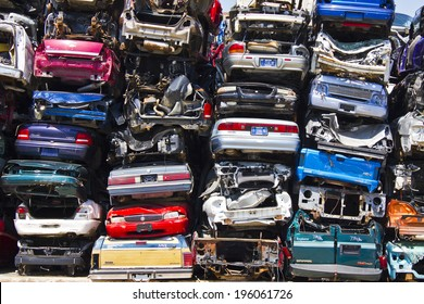 KOKOMO, INDIANA - CIRCA AUGUST 2013 - A Pile of Stacked Junk Cars - Discarded Junk Cars Piled Up After Crushing