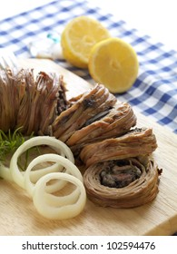 kokoretsi-traditional and famous greek plate made of chopped lamb liver, wrapped with lamb intestines and baked on a spit on charcoal