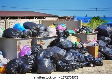KOKTEBEL / CRIMEA - AUGUST 23, 2019: Dump in the Crimea. An overflowing dump. Garbage bags