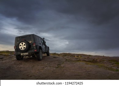 Kola peninsula. Murmansk region, Russia, September 12, 2018: black Jeep Wrangler Sahara on the shore of the Barents Sea. Wrangler is a compact four wheel drive off road and sport utility vehicle