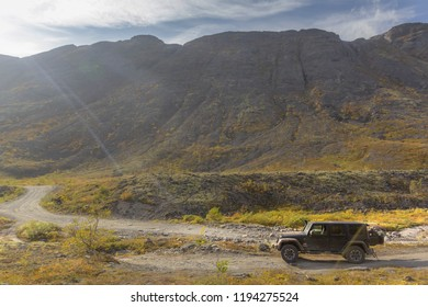 Kola peninsula. Murmansk region, Russia, September 10, 2018: black Jeep Wrangler Sahara on a mountain pass in the Murmansk region. Off road and sport utility vehicle