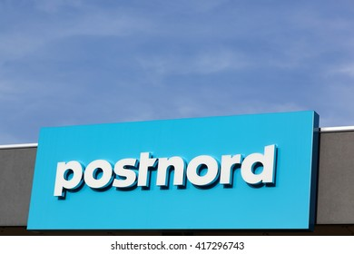 Kolding, Denmark - May 6, 2016: Postnord logo on a wall. PostNord is the name of the holding company of the two merged postal companies Posten AB and Post Danmark that were officially merged in 2009