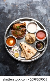 Kolhapuri chicken Thali is a popular Indian/asian food platter consists of poultry meat, egg curry with chapati ,rice, salad and sweet Gulab Jamun