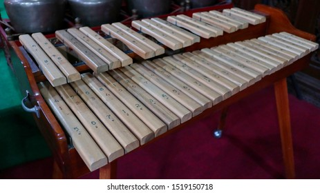 Kolintang or kulintang is a musical instrument consisting of rows of small gongs placed horizontally. This instrument is played accompanied by a larger hanging gong and drum.
