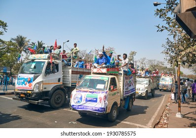 Kolkata, 02-28-2021: Mini truck loaded with political supporters of Indian Secular Front (ISF), on their way to attend mega political rally organised at Brigade Parade ground.