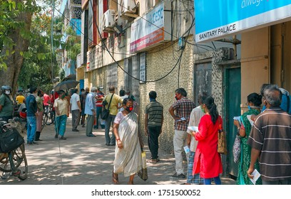 Kolkata, 06/02/2020: India Unlock 1.0. People in street waiting in long queue to pay monthly electricity bills, in front of CESC (Calcutta electric supply corporation) cash office.