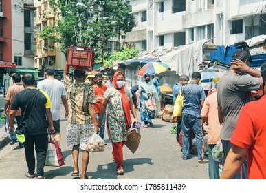 Kolkata, 07/26/2020: A crowded bazaar (community marketplace) near a residential locality. Gathering of people around market sellers are seen, most of them not maintaining social distancing.
