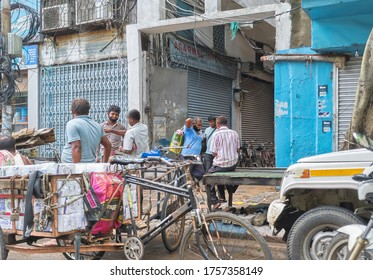 Kolkata, 6/13/2020: Gathering of local people, mostly small business owners  & van drivers at Burrabazar, a lively shopping area of wholesale market in city. Due to lockdown, most shops are closed.