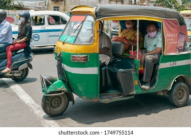Kolkata, 6/2/2020: India Unlock 1.0, the easing up of Covid lockdown, more people are seen on street. Closeup of an auto rickshaw running in street carrying passengers. Everyone is wearing face mask.