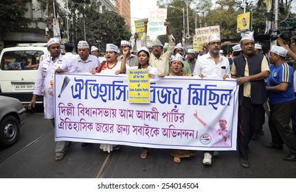 Kolkata AAP volunteers organized a victory procession today on occasion of swearing in ceremony of Arvind Kejriwal led Government at Delhi on February 14, 2015 in Calcutta, India