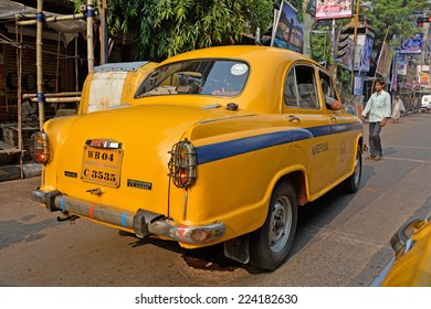 KOLKATA (CALCUTTA), WEST BENGAL, INDIA - OCTOBER 02, 2014: Back of an  isolated Yellow taxi. Ambassador, modeled after the British Morris Oxford, was the first car to be made in this country.