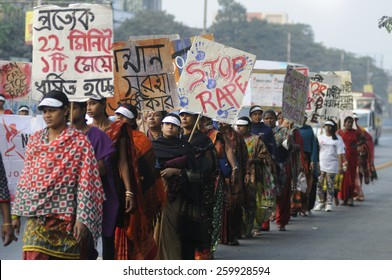 KOLKATA - DECEMBER 16 : Indian women with signs and banners during a rally to remember the gang raped victim from New Delhi in the year 2012 - on December 16, 2014 in Kolkata , India.
