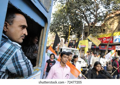 KOLKATA- DECEMBER 20: A stranded man watches the procession passing by during a silent rally in Kolkata, India on December 20, 2010.