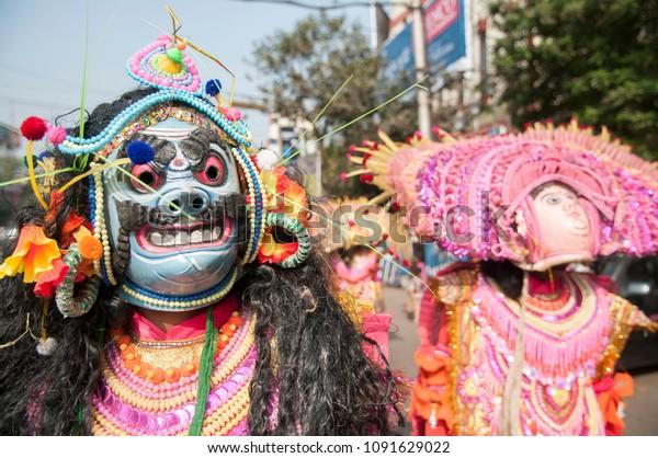 KOLKATA - DECEMBER 28: Chhau dancers wearing Chhau masks  performing during a Bengali Heritage Rally to kick off North American Bengali Conference 2015  in Kolkata, India on 28th December 2014.
