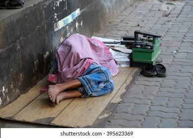 KOLKATA - FEBRUARY 09: Homeless people sleeping on the footpath of Kolkata. on February 09, 2014 in Kolkata, India