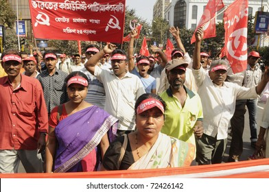 KOLKATA- FEBRUARY 13:   Women supporters came on to the streets to show their support  towards the government during a political rally  in Kolkata, India on February 13, 2011.