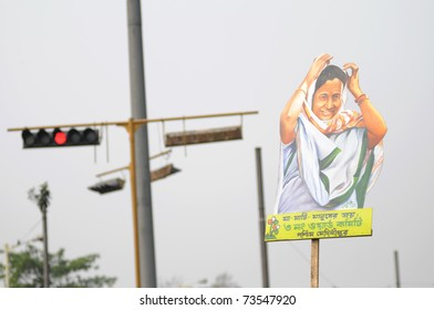 KOLKATA - FEBRUARY 20: All India Trinamool Congress Supporters with a cut out of Ms.Mamata Banerjee during a rally organized to kick the 2011 election champagne,in Kolkata,India on February 20,2011.