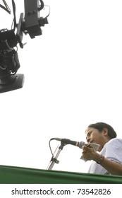 KOLKATA - FEBRUARY 20: A camera follows  Indian Railways minister Ms. Mamata Banerjee while she speaks during a political rally in Kolkata, India on February 20, 2011.