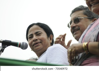 KOLKATA - FEBRUARY 20:  Indian Railways minister Ms. Mamata Banerjee sharing a laugh with her party leaders during a political rally organized by her party, in Kolkata, India on February 20, 2011.
