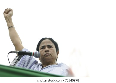KOLKATA - FEBRUARY 20:   Indian Railways minister Ms. Mamata Banerjee gesturing a sign of solidarity  during a political rally in Kolkata, India on February 20, 2011.