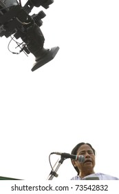 KOLKATA - FEBRUARY 20:  A video camera records every action of  Indian Railways minister Ms. Mamata Banerjee  during a political rally in Kolkata, India on February 20, 2011.