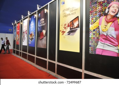 KOLKATA- FEBRUARY 20:  Visitors passing by a panel of displays ,during the Information and Communication Technology (ICT) conference and exhibition in Kolkata, India on February 20, 2011.