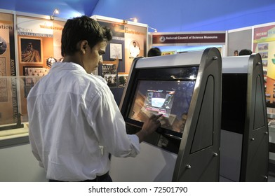 KOLKATA- FEBRUARY 20: A  young man operates a touch screen, during the Information and Communication Technology (ICT) conference and exhibition in Kolkata, India on February 20, 2011.