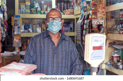 Kolkata, India, 03/22/2020: Awareness of common people during COVID-19 in outbreak in city. A grocery    owner with protective face mask. Among nationwide closure, grocery shops will remain open.