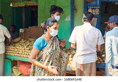 Kolkata, India, 03/22/2020: City people seen buying potatoes, often stockpiling in anticipation of food scarcity due to corona outbreak. Shot during COVID outbreak in Kolkata.