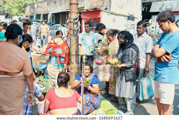 Kolkata, India, 03/22/2020: City people seen buying vegetables inside a market, often stockpiling in anticipation of food scarcity due to corona outbreak. Shot during COVID outbreak in Kolkata.