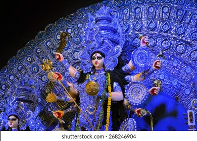 Kolkata, India - 10 October 2013:  An idol of revered goddess Durga standing in an unidentified pandal in the city of Kolkata during Durga Puja festival. A pandal is a temporary temple, erected during