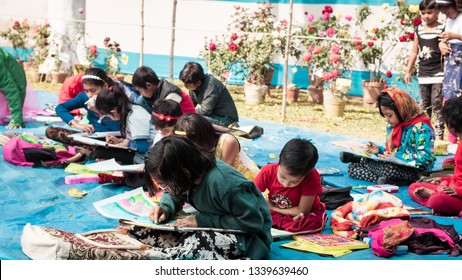 Kolkata, India, 10th March, 2019: Inter school students in a sit and draw competition on the occasion of spring festival. The kids were given task on nature and it's elements as a theme.