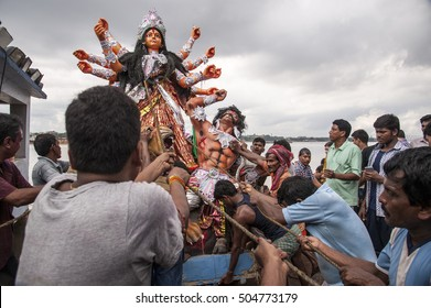 Kolkata / India 11 October 2016,  An Idol of Goddess Durga is carried by devotees for immersion into the river Hoogly at Babughat Kolkata West Bengal India