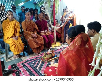 Kolkata, India - 19th April 2019 Young buddhist lama attending Indian Hindu wedding for blessing bride and groom. Bride was a Buddhist follower where groom was a Hindu in a Bengali wedding ceremony.