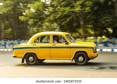 KOLKATA - INDIA - 22 JANUARY 2018. An Ambassador cab taxi with passengers on board is running on the streets of Kolkata. Kolkata (Calcutta) is the capital of the Indian state of West Bengal, India.