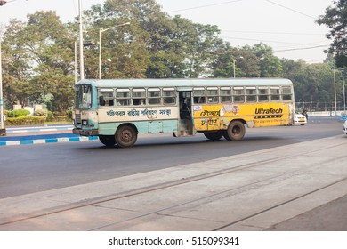 KOLKATA, INDIA - 22 Oct 2016: A brightly painted local bus speeds through the city on October 22, 2016 in Kolkata (Calcutta), India