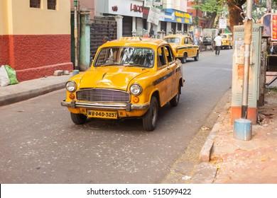 KOLKATA, INDIA - 22 Oct 2016: An Ambassador cab taxi drives down Sudder Street on the morning of October 22, 2016 in Kolkata (Calcutta), India