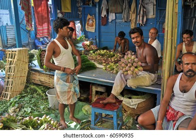 KOLKATA, INDIA - 27 OCTOBER: An unidentified group of people buy and sell flowers on flower market in Kolkata on October 27, 2009.  The Kolkata flower market is the largest one in eastern India.