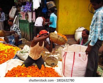 KOLKATA, INDIA -29 March 2013: Flower market in Kolkata city, people selling different flowers and beautiful garlands near Howrah Bridge in Kolkata, West Bengal, India